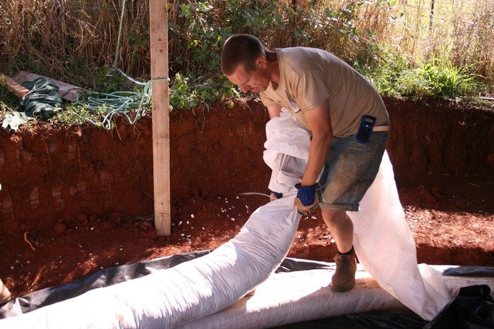 Laying a bag in a SuperAdobe structure