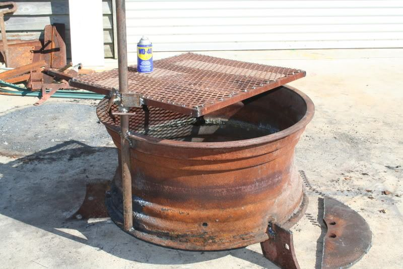 Recycled tire rim bbq and fire pit ideas2live4 for Materials needed to build a fire pit