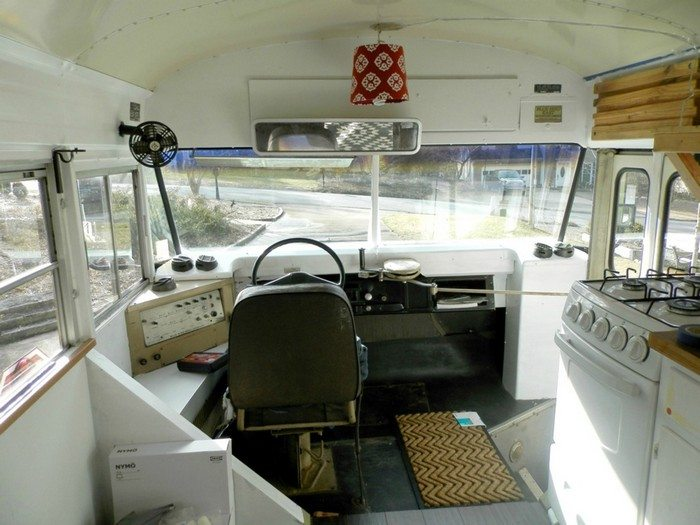 Before: Yellowed with age interiors of the bus