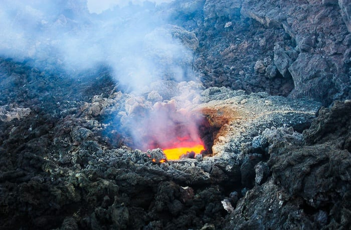 Volcanic vents spew lava and poison gas.