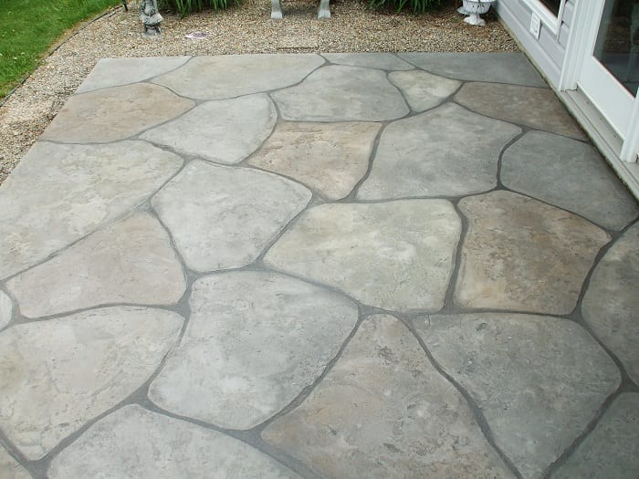 You should regularly apply a concrete sealer on all of your flat exterior concrete surfaces.