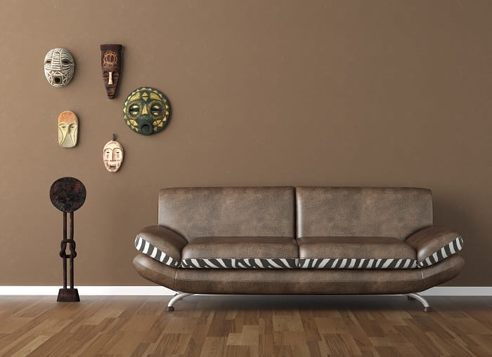 The color scheme consists of subtle earth tones with deep, rich browns, cream, or dark orange.