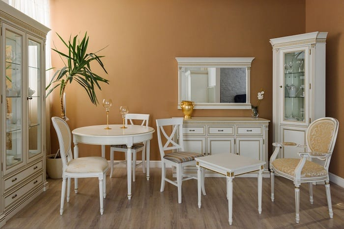 Current decor styles have made mixing colors, upholstery, and shapes of dining chairs trendy.