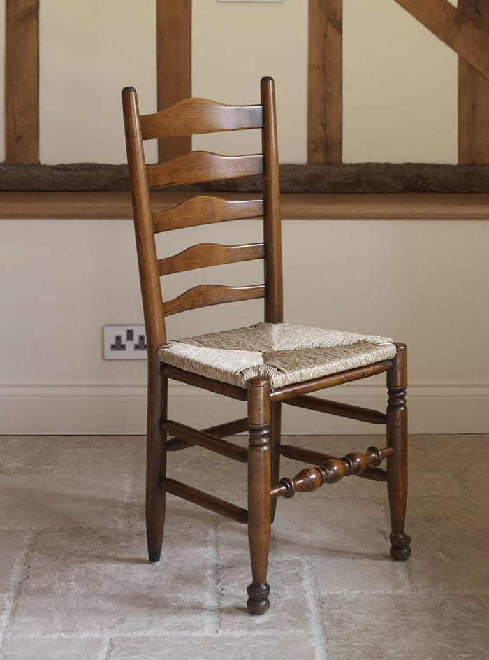 The ladder back chair has returned to the living rooms and dining areas of countless homes.