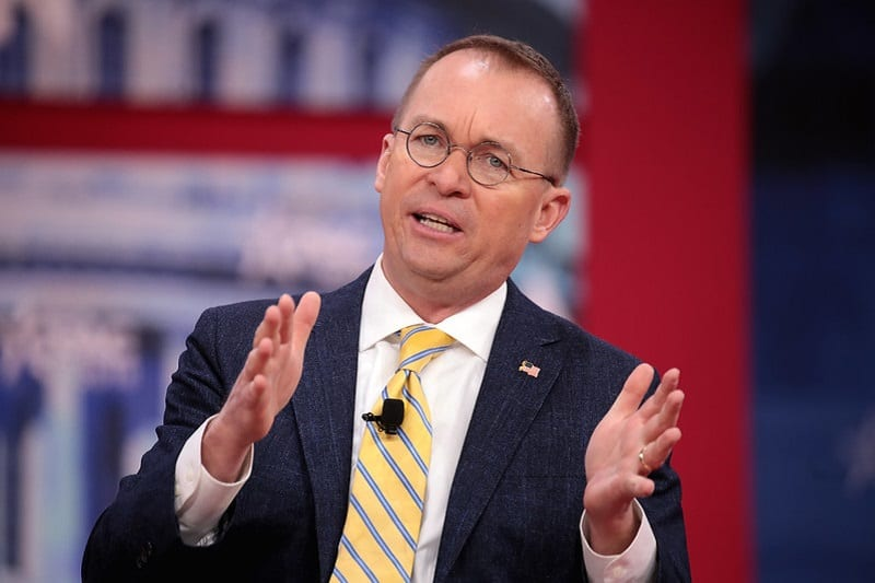 Acting White House chief of staff Mick Mulvaney has accused the Trump administration's critics of exaggerating the threat of the virus.
