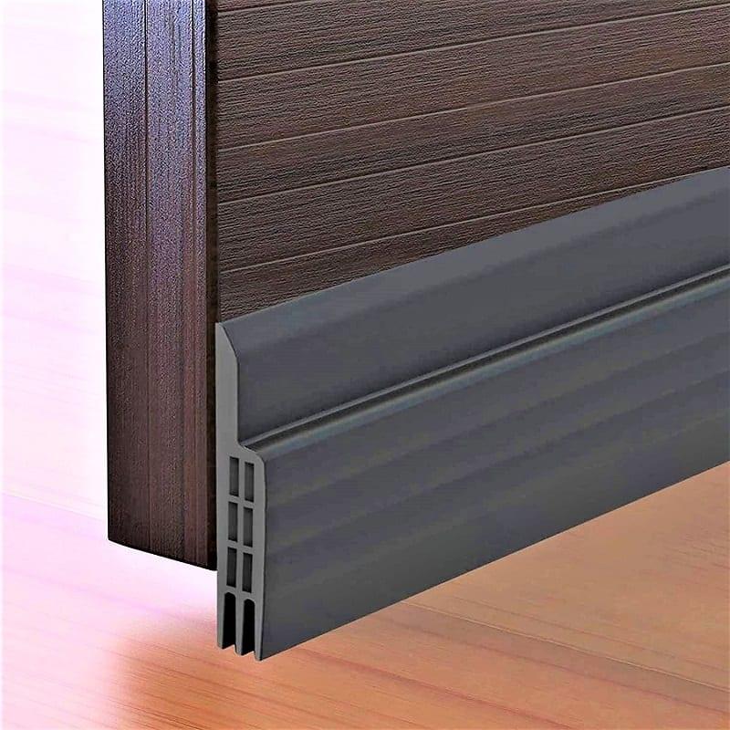 Door sweeps like the Suptikes Door Draft Stopper close the gap beneath the door and the floor.